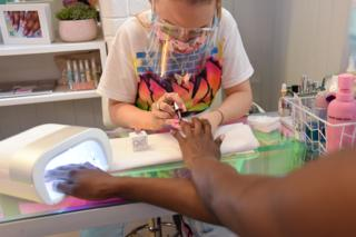 Anouska Anastasia works on a clients nails at NUKA Nails, West London.