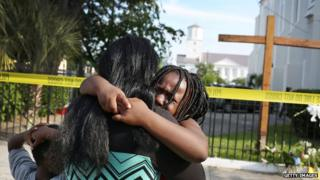 Mourners gathered outside the Emanuel African Methodist Episcopal Church in Charleston after a mass shooting that killed nine people.