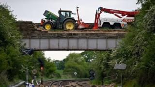The tractor on the damaged bridge