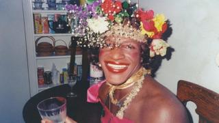 Transgender icon Marsha P Johnson wearing a rose crown of flowers