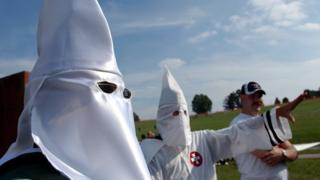 Members of the Knights of the Ku Klux Klan participate in a neo-Nazi rally on the amphitheatre stage at Valley Forge National Historic Park, in Valley Forge, Pa.