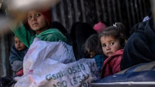 Children on back of lorry as part of convoy