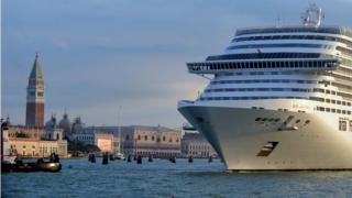 A giant cruise ship arrives in front of Saint-Mark's square in Venice on September 21, 2013