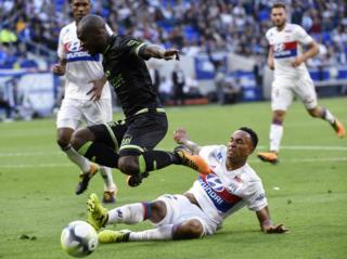 "Guingamp""s French-Congolese defender Jordan Ikoko (L) vies with Lyon""s Dutch defender Kenny Tete (bottom) during the French L1 football match Lyon (OL) vs Guingamp (EAG), on September 10, 2017 at the Groupama stadium in Décines-Charpieu near Lyon, southeastern France."