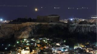 The ancient Parthenon temple is pictured atop the Acropolis hill during Earth Hour in Athens, Greece