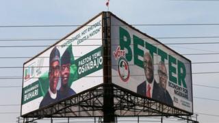 Bill board of di two main presidential candidates