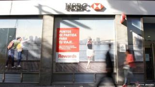 People walk past an HSBC branch in Buenos Aires, Argentina
