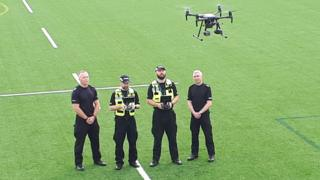 Police officers with drone