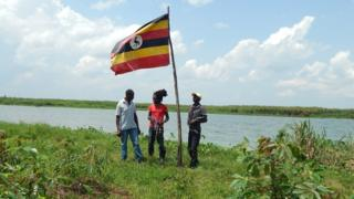 Residents by the flagpole