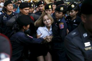 A student activist is detained during a silent protest, Bangkok, Thailand