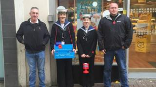Nottingham Sea Cadets said the two children unintentionally posed for the picture with the two men