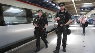 Armed police at Euston station about to board a Virgin train to Birmingham New Street