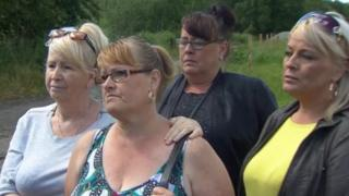 Philomena McKee (second left) and family members at the scene in County Meath