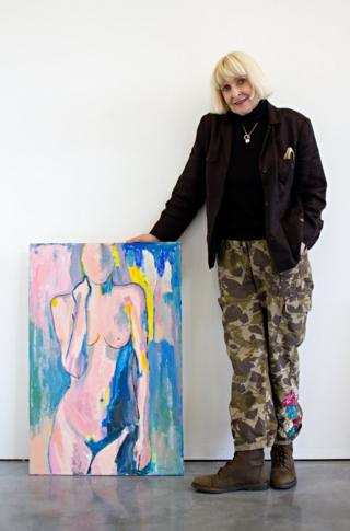 Geraldine Crimmins standing next to her artwork