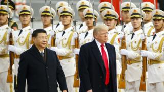 US President Donald Trump and China's President Xi Jinping at a ceremony in China