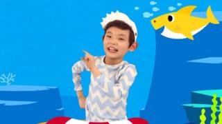 A child doing the Baby Shark Dance