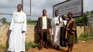 Students of Baptist High School, Iwo wearing Christian garments to school