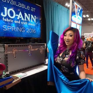 Yaya holding one of her cosplay fabrics