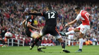 Arsenal's Alexis Sanchez scores against Manchester United in the Premier League on 4 October, 2015