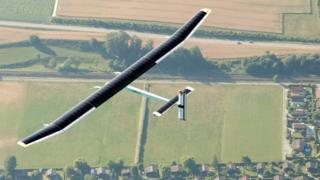 Solar Impulse 2 fling over fields and towns