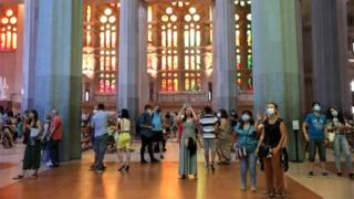 Health workers and off-duty police officers were among those granted access to the Sagrada Familia basilica in Barcelona on Saturday