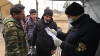 Macedonia policeman checking documents on border (February 2016)