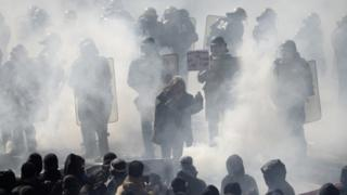 Protester clash with riot police during the traditional May Day demonstration in Paris on 1 May