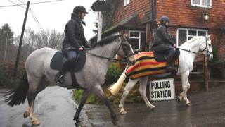 Horse riders arrive at a polling station in Chiddinstone Hoath