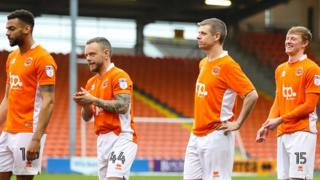 Kevin Stuart (second from right) with Blackpool FC players