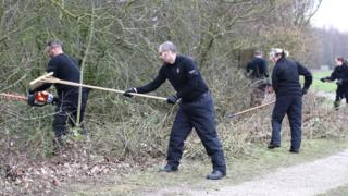 Police search an area near the Oak Road Playing Fields