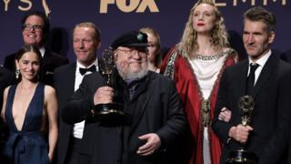 Game of Thrones creator George RR Martin with cast members at the Emmys
