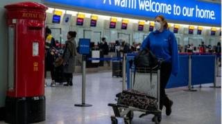 Woman travelling through Heathrow