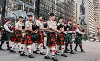 South African pipers marching in Durban, South Africa - Sunday 11 November 2018