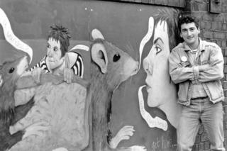 Francis Gomila with his Alice in Smerick mural