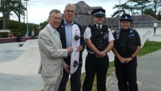 Arfon Jones with Councillor Dylan Rees, North Wales Police Inspector Jason Higgins and PCSO Katy Madrigal