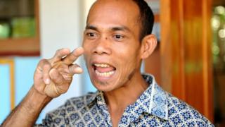 Guru bahasa isyarat di Bali.