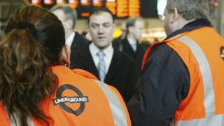 London Underground staff at Euston station help confused commuters. (