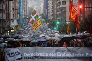"A demonstration against Article 155 of the Spanish Constitution allowing the Spanish Government to take control of Catalan institutions, in Bilbao, 4 November 2017. The banner reads ""Democracy and the right to decide""."