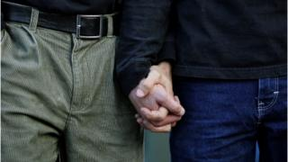 Gay couple holding hands in New York in 2006