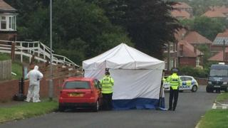 The body was found on Greenfield Road in the early hours of Wednesday