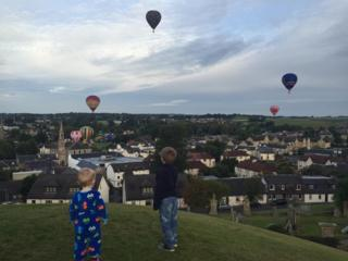 Nathan and Andrew watch hot air balloons in Strathaven