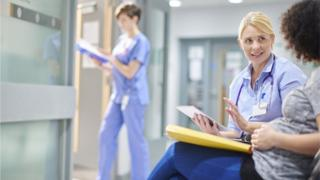 Woman chatting to a female doctor