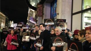 Group with banners outside cinema