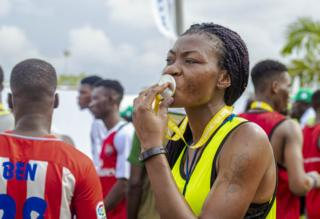 Woman kissing the medal