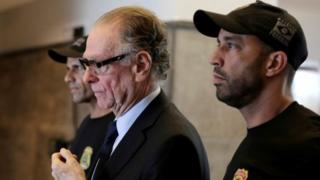 Brazilian Olympic Committee (COB) President Carlos Arthur Nuzman leaves the Federal Police headquarters heading to jail, in Rio de Janeiro, Brazil, October 5, 2017