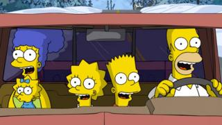 The Simpsons in a car