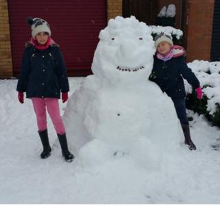 Girls and a snow gorilla