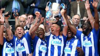Thatcham Town lift the FA Vase trophy at Wembley.