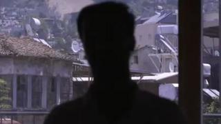 A screengrab from the BBC documentary Syria: The World's War, showing a man's head in silhouette
