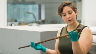 Collections Officer Sam Jenkins with the Peterloo cane